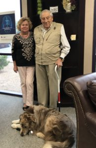 Sully de Fontaine, his wife and faithful service dog visit Hearing Associates of Las Vegas