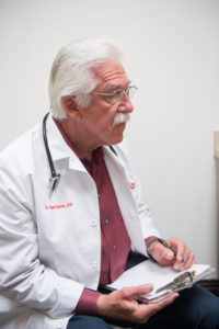 Dr. Dale Carrison knows first-handthat hearing aids save lives.